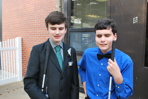 Two students are dressed and ready to go to the prom.